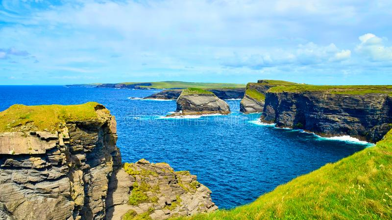 Cliffs of Kilkee in Ireland county Clare. Ocean view, Tourist destination. The Kilkee Cliff walk is a scenic 2 to 3 hour 8km moderate loop walk along the Kilkee royalty free stock photos