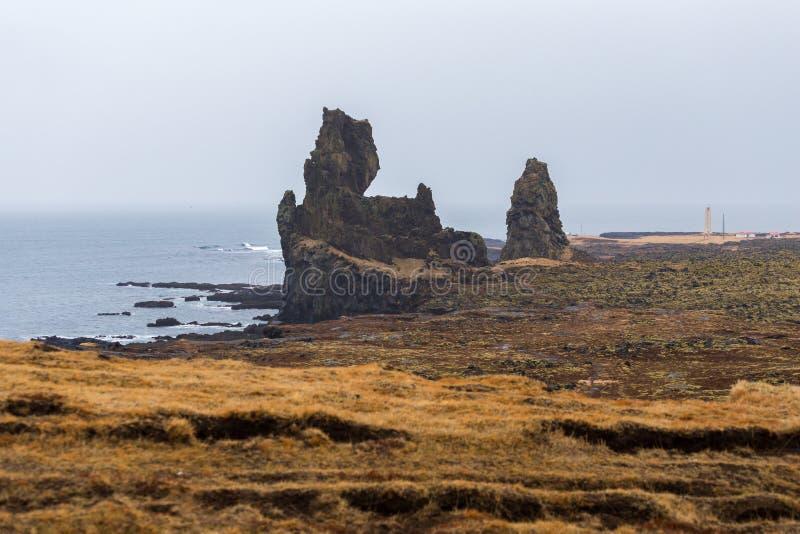 The cliffs at Londrangar, two basalt pinnacles rising from sea stock image
