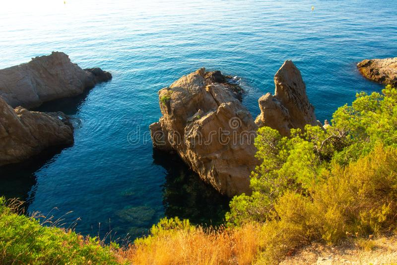 Cliffs in mediterranean sea in coast of Lloret de Mar, Costa Brava, Spain royalty free stock photo