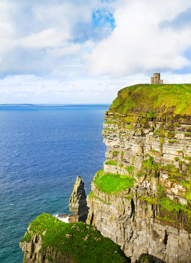 Cliffs of Moher and O`Brien`s tower, west coast of Ireland, County Clare at wild atlantic ocean. Cliffs of Moher and O`Brien`s tower, west coast of Ireland royalty free stock photography