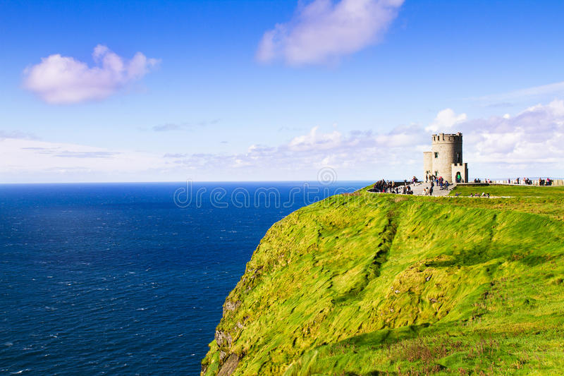 Cliffs of Moher and O`Brien`s tower, west coast of Ireland, County Clare at wild atlantic ocean. Cliffs of Moher and O`Brien`s tower, west coast of Ireland stock photography