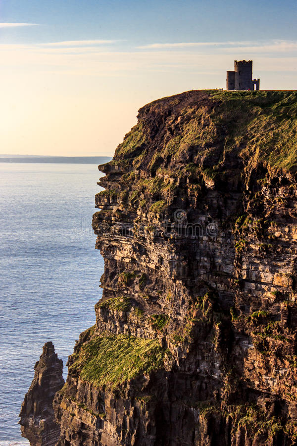 Cliffs of Moher and stone building stock photography
