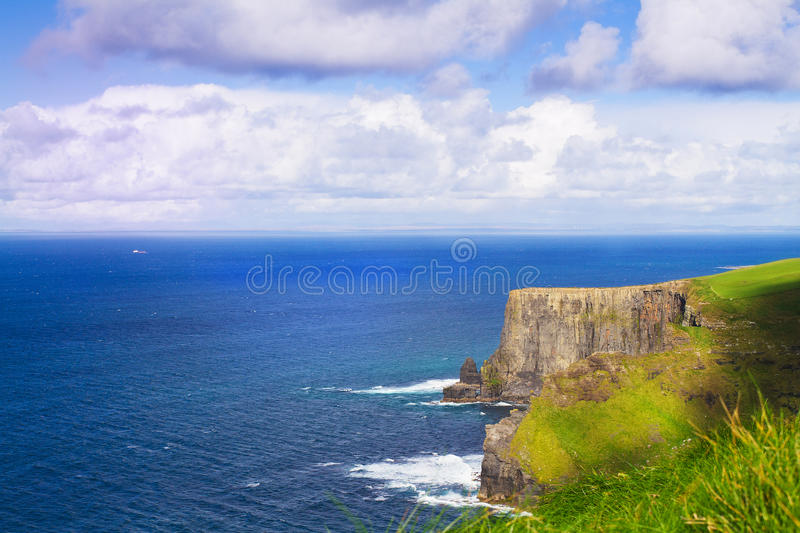 Cliffs of Moher, west coast of Ireland, County Clare at wild atlantic ocean. Cliffs of Moher, west coast of Ireland, County Clare at wild atlantic ocean stock photo