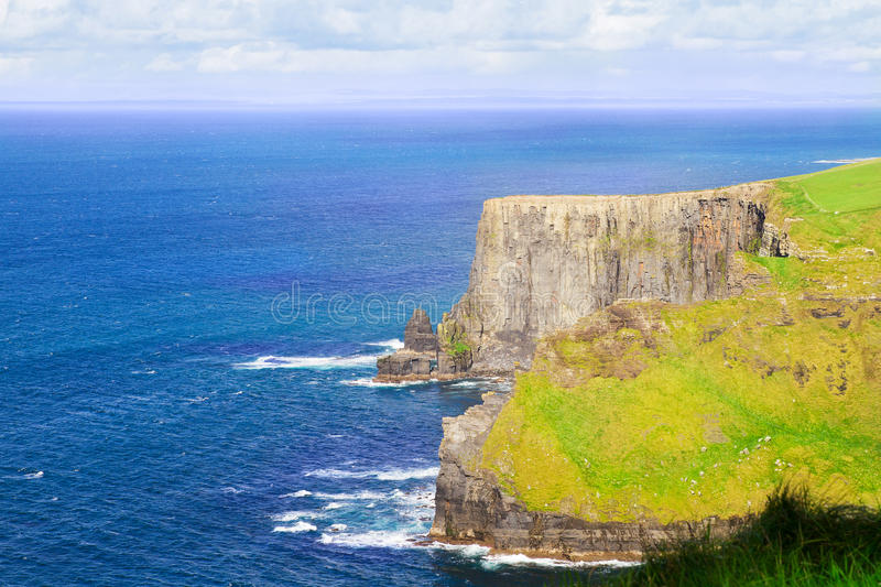 Cliffs of Moher, west coast of Ireland, County Clare at wild atlantic ocean. Cliffs of Moher, west coast of Ireland, County Clare at wild atlantic ocean royalty free stock image