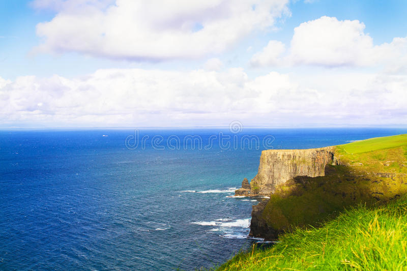 Cliffs of Moher, west coast of Ireland, County Clare at wild atlantic ocean. Cliffs of Moher, west coast of Ireland, County Clare at wild atlantic ocean royalty free stock photos
