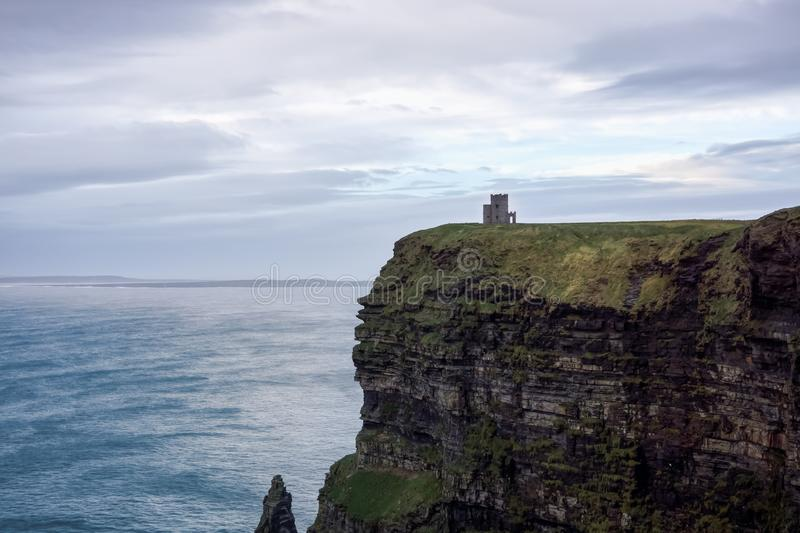 Cliffs of Moher in Wild Atlantic Way with ruins of tower on edge of cliff stock image