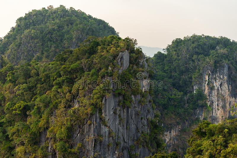 Cliffs and mountains in Thailand is covered by tropical greenery royalty free stock images