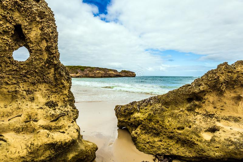 The cliffs and sandy beaches. The Great Ocean Road of Australia. Picturesque seashore, coastal cliffs and sandy beaches of the Pacific. The concept of exotic stock image