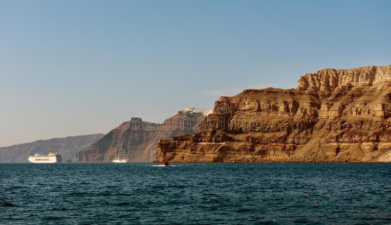 Cliffs of Santorini island, view from sea port.  stock photography