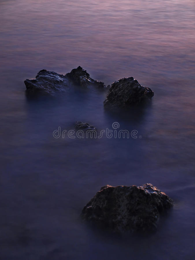 Cliffs in the sea stock image