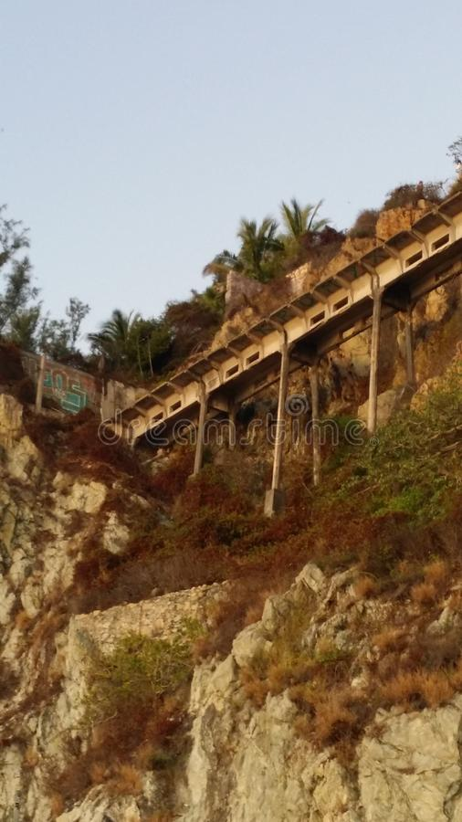 Cliffside bridge stock photos