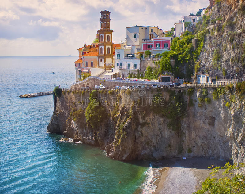 Cliffside Village, Amalfi Coast, Italy. The city of Atrani sits on the edge of the dramatic, rugged cliffs of the Amalfi Coast, with a beach below, on the royalty free stock photos