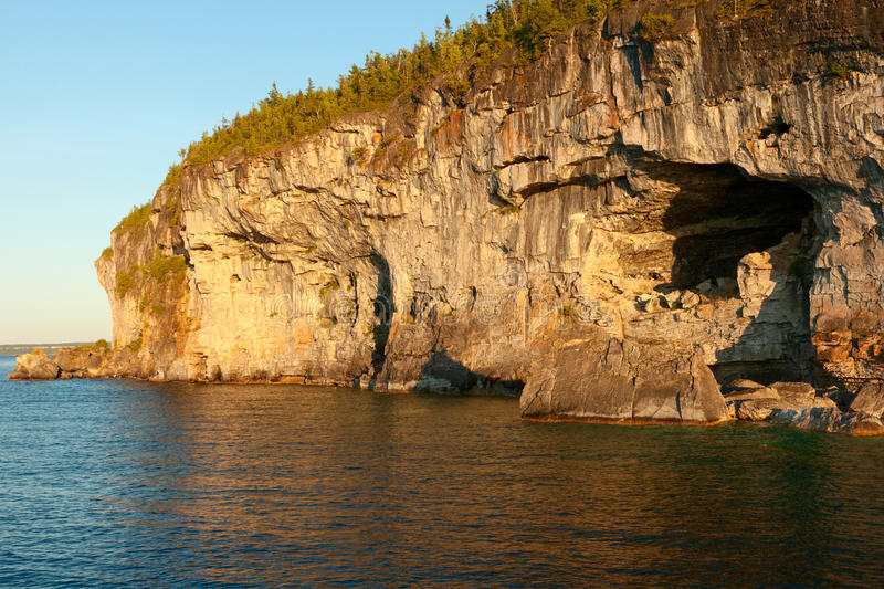 Cliifs with Cave at Lakeshore stock photo
