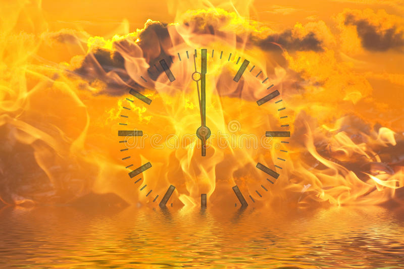 Climate change. Flames and a clock over the sea symbolizes the climate change stock image