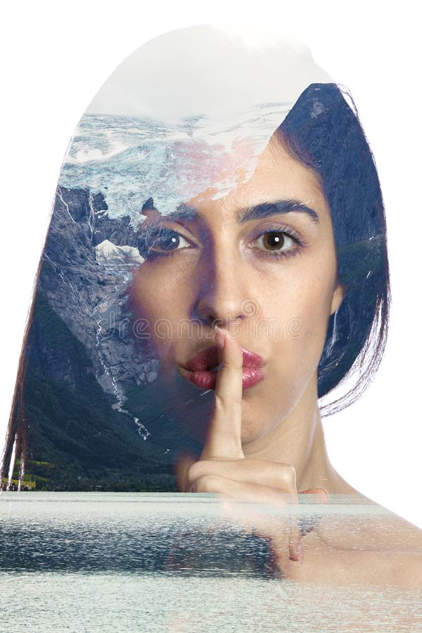 Climate change commitment concept photo. Double exposure photo with a girl asking for silence and a glacier melting on the background inside of the girl face royalty free stock photography