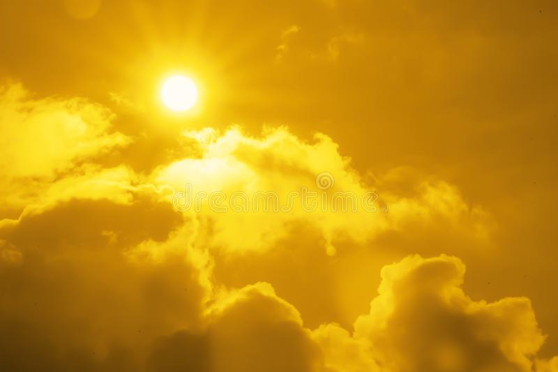 Climate change concept - sun on a background of clouds. Climate change concept - bright sun on a background of clouds stock images