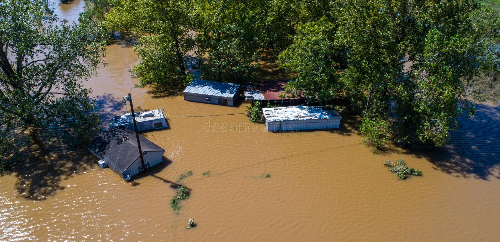 Climate Change. Flooded homes during storm surge of Hurricane Harvey. Water up to the rooftop massive flooding in East Texas stock photo