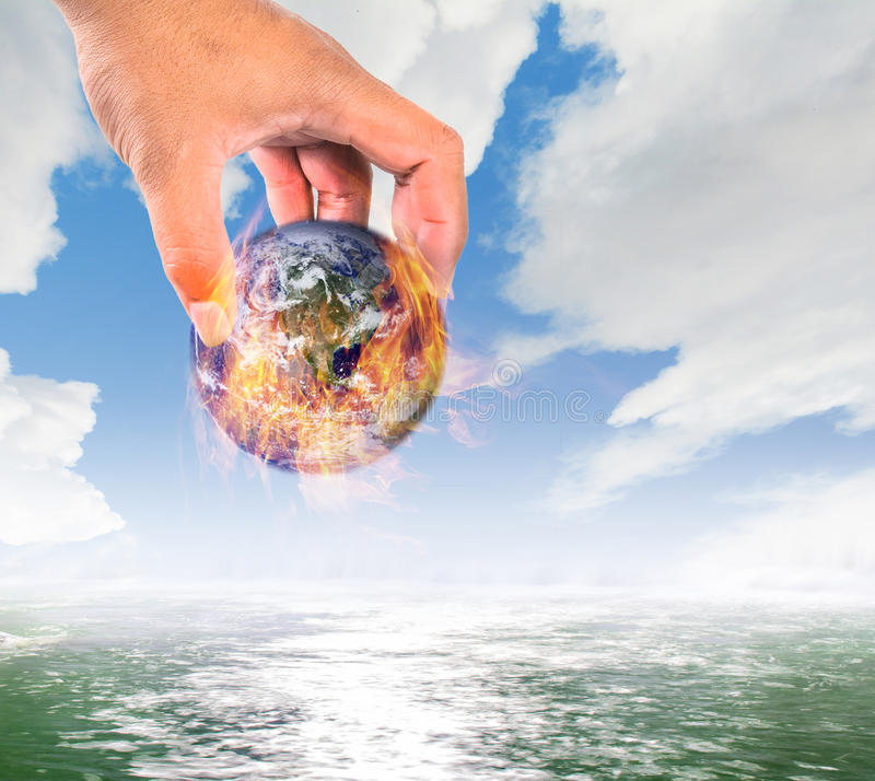 Climate change,Global warming, fire global put in water, safe th royalty free stock photography