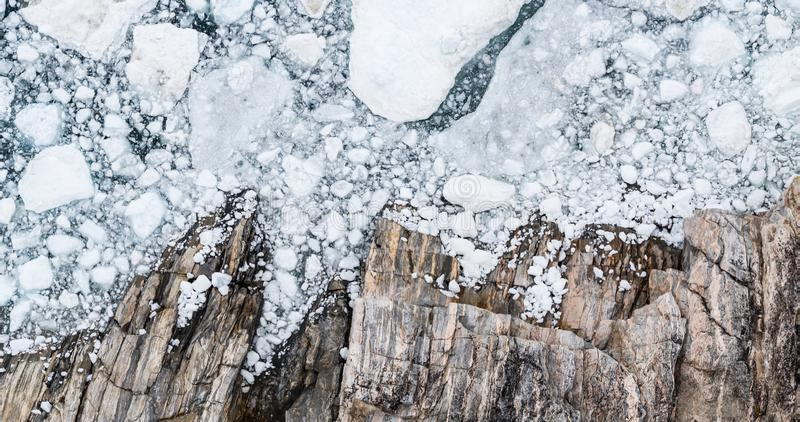 Climate Change and Global Warming - Icebergs drone aerial image top view stock photography