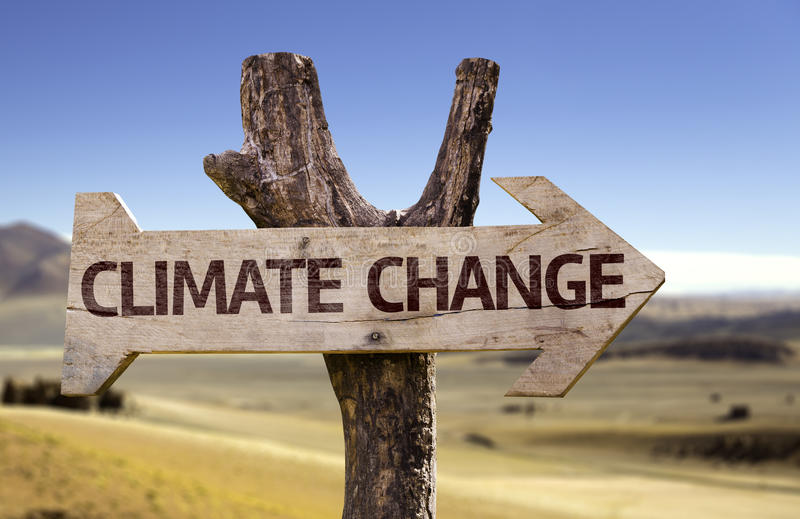 Climate Change wooden sign with a desert background royalty free stock photos
