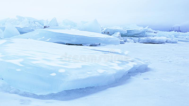 Climate and Mankind. Ice drift with smoke stacks in the background; can be used as a concept illustration of human impact on the environment royalty free stock photos