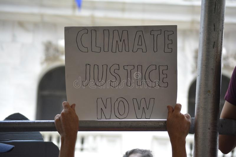Climate protester in New York City. stock images