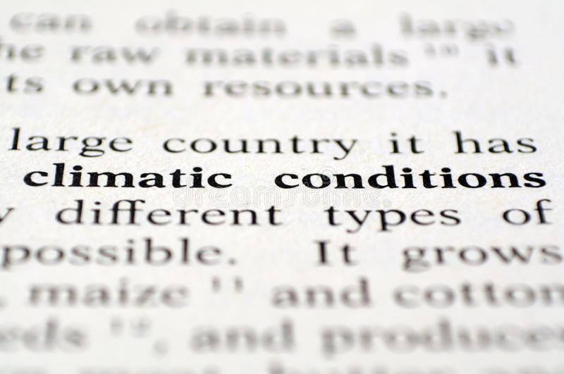 Climatic conditions. Macro of climatic conditions words over white paper stock image