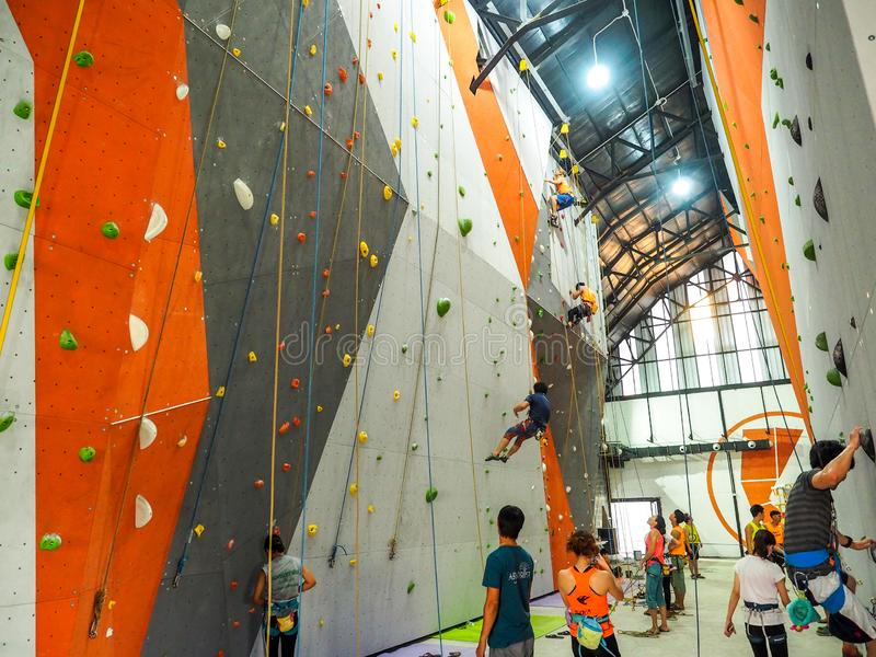 Climb central bangkok Thailand : Attractive of many people climbing up the wall in gym royalty free stock photos