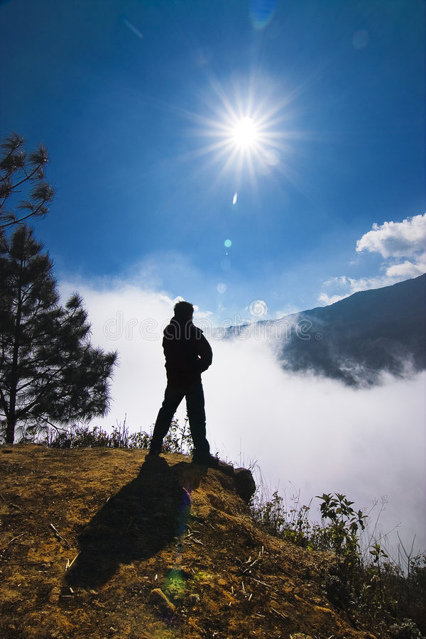 Climb mountain a member. A mountain climbing member that stands on the summit of hill royalty free stock photos