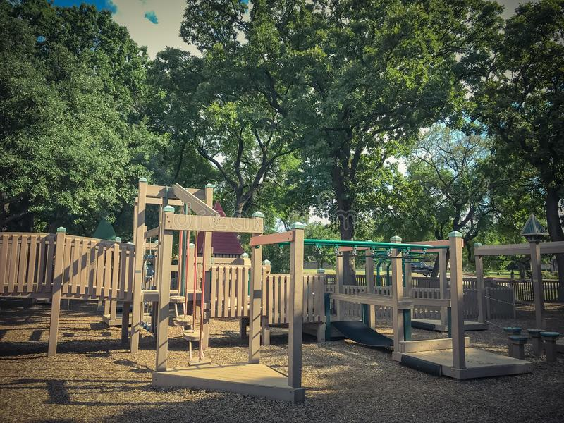 Climb structure at public wooden castle style children playground in America stock images