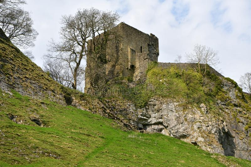 Peak District UK, old historic Peveril Castle, climb stock photography