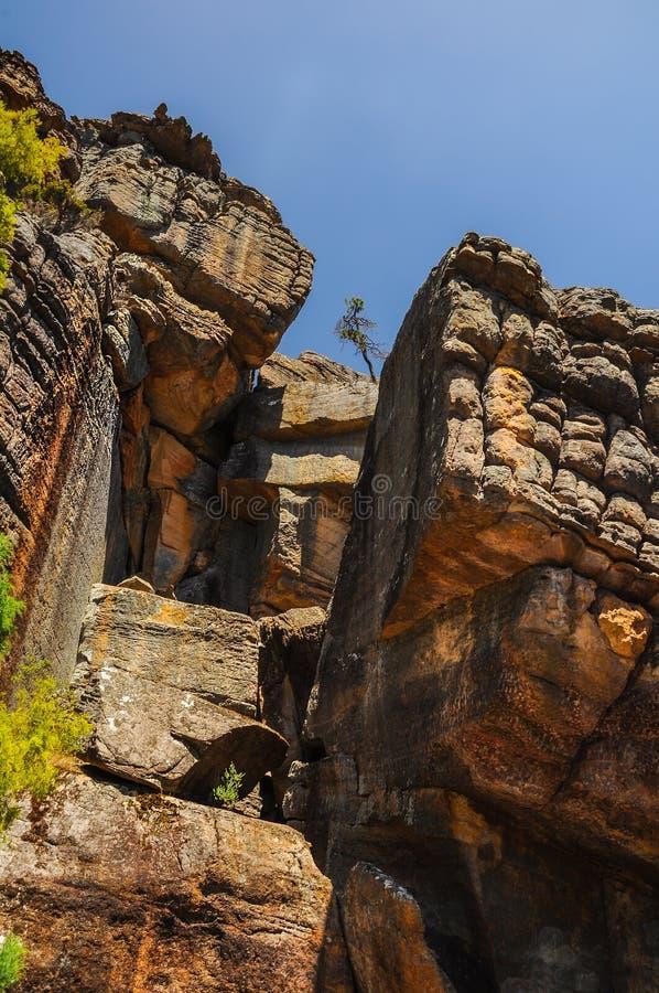 Climb to the top of a rock Pinnacle. Via the Grand Canyon stock photo