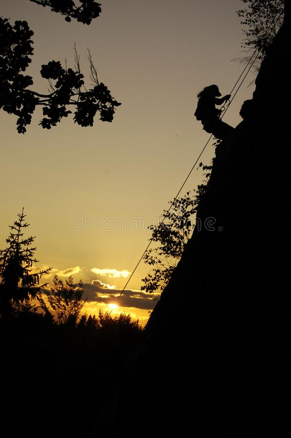 Climb up, climber in the rock, sunset in the mountains,  sport, person, undercover stock photos