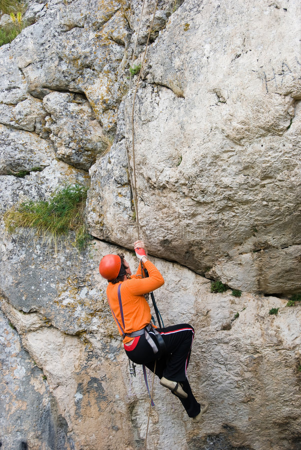 Climber. The climber rises upwards on a rock stock photography