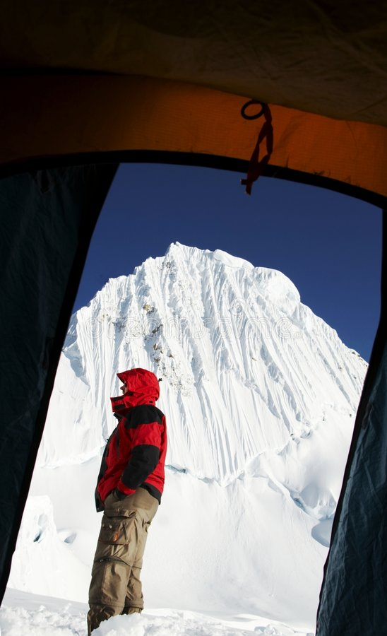 Climber and Alpamayo peak from the tent royalty free stock images