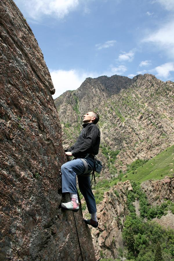 climber on arete stock images