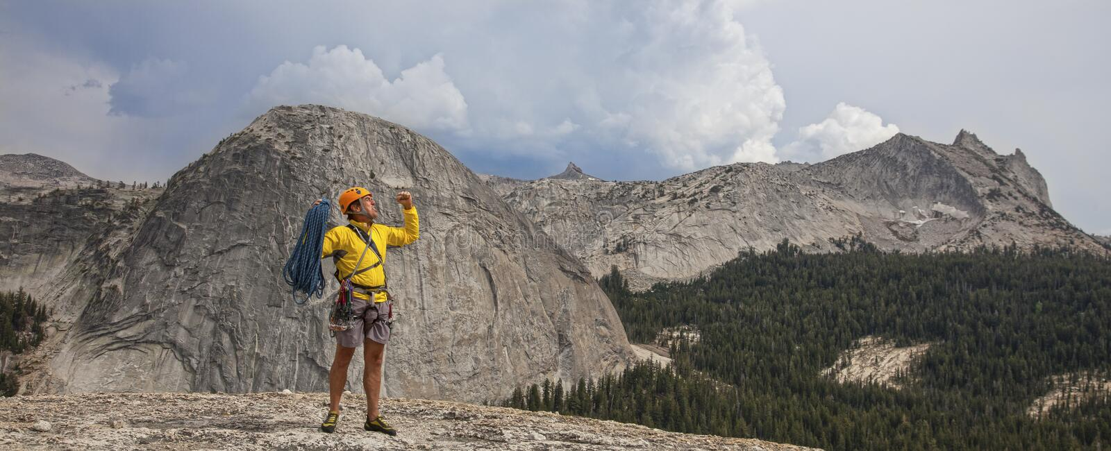 Climber celebrates on the summit. royalty free stock images