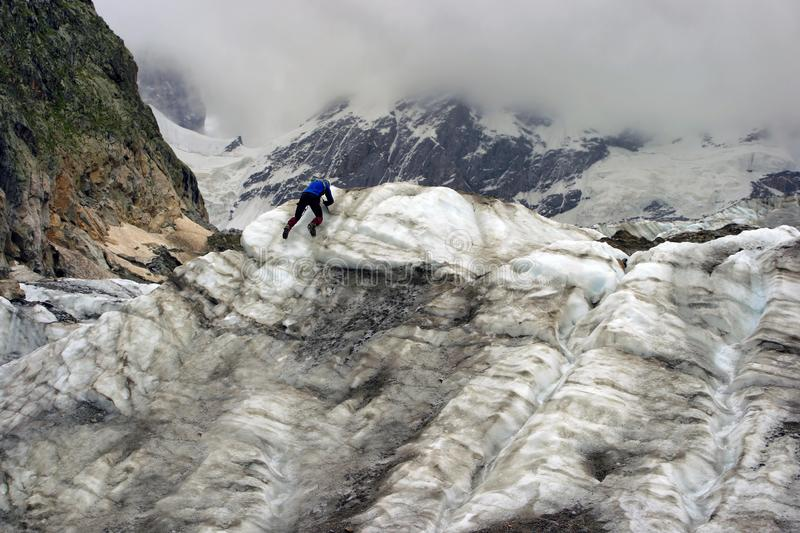 The climber climbs the glacier. stock images
