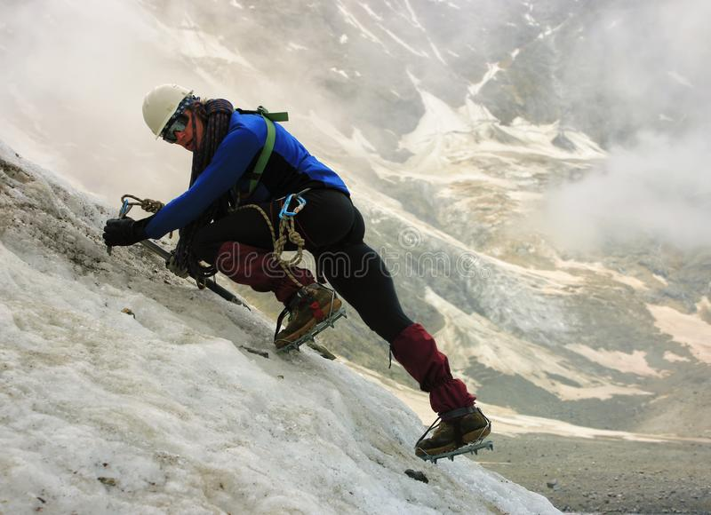The climber climbs the glacier. royalty free stock images