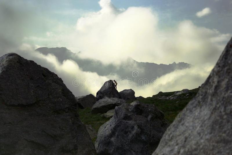 The climber climbs on the rocks in the distance. royalty free stock photo