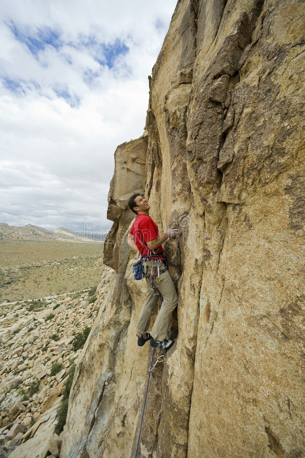 Download Climber Clinging To A Cliff. Stock Image - Image: 7084903