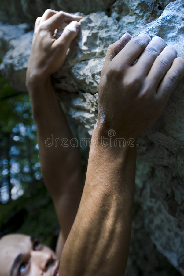 Climber on crux stock photography