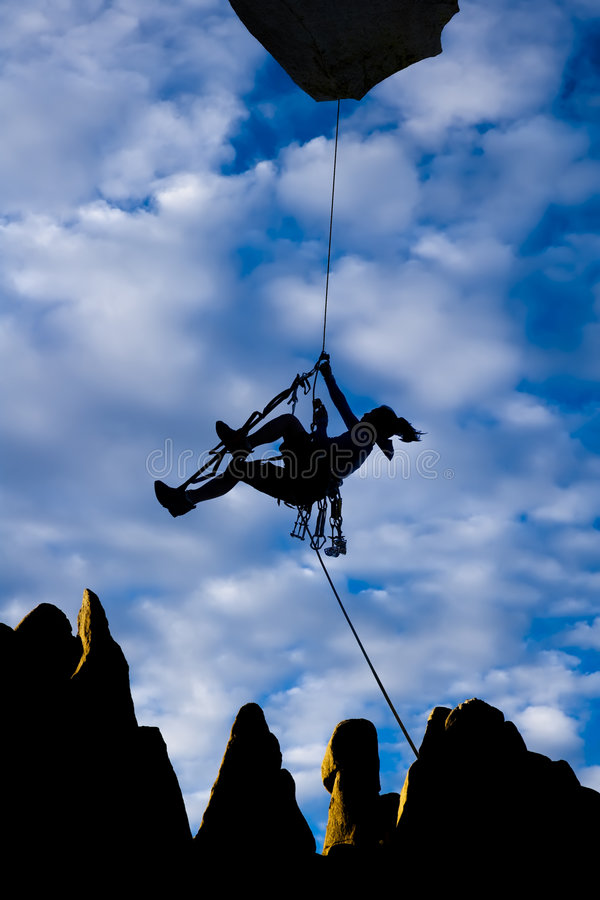 Download Climber Dangling From A Rope. Stock Image - Image: 7495177