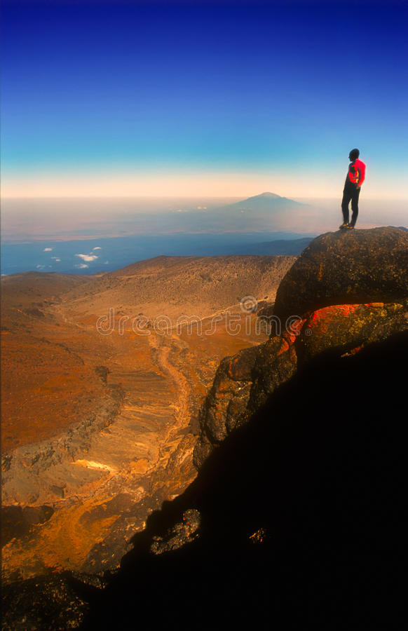 Climber enjoying the view on Mt Kilimanjaro stock images