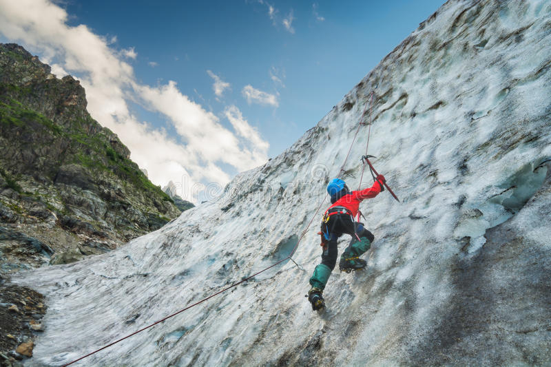 Climber on a glacier royalty free stock images