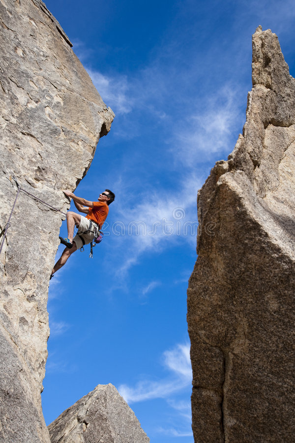 Climber going for the summit. stock images