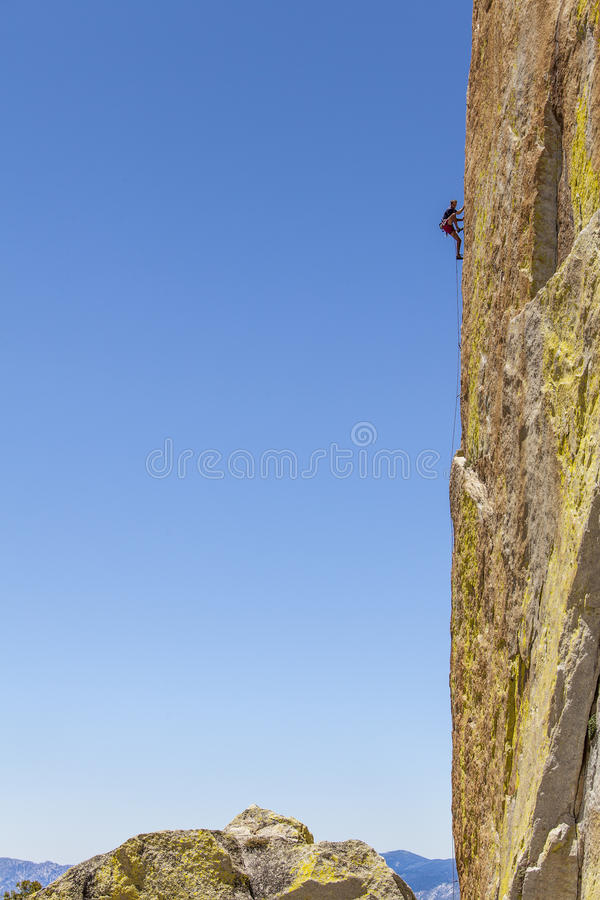 Climber gripping the rock. royalty free stock photos