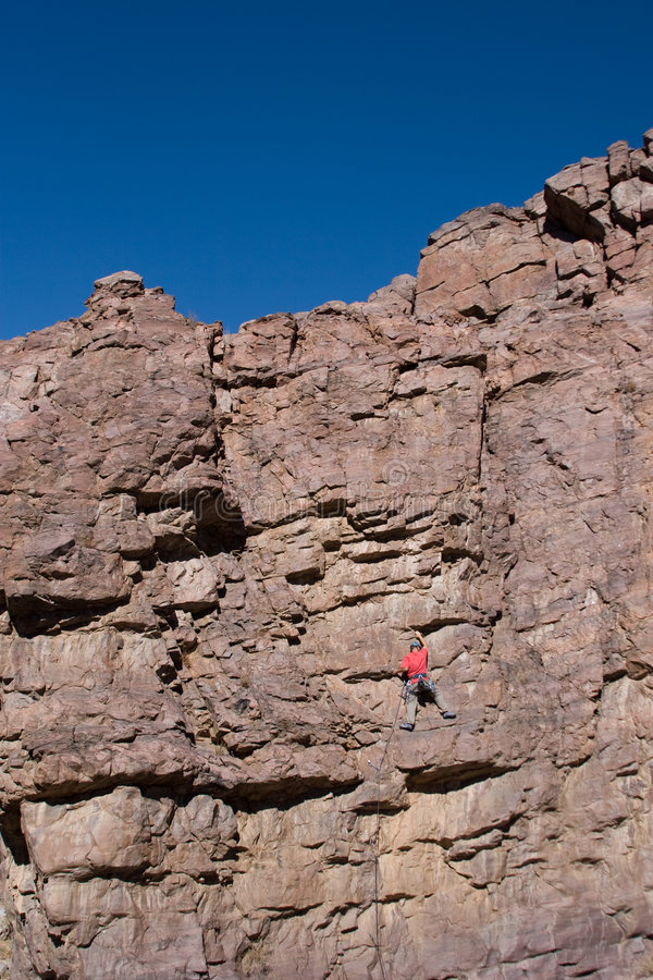 Free Climber Halfway Up Cliff Stock Photography - 3440222