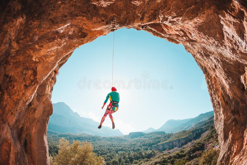 The climber is hanging on a rope. royalty free stock images