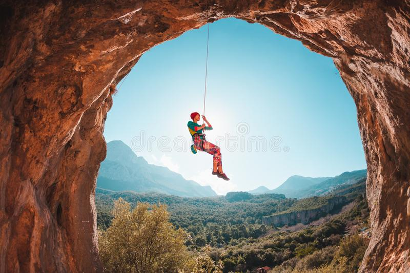 The climber is hanging on a rope. stock images